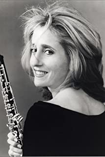 Blair Tindall with her oboe and looking over her shoulder